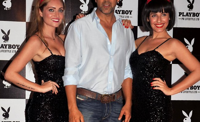 Akshay Kumar (C) poses as he attends the unveiling of a new Playboy bunny costume