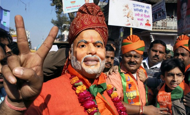 BJP supporters celebrate the party\'s victory in Gujarat assembly elections, in Varanasi