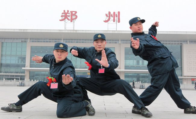 Kung fu masters from the Songshan Shaolin Kung Fu College posing for a photo