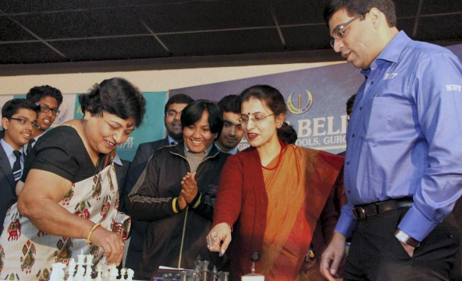 World Chess Champion Viswanathan Anand plays with students and teachers at a school to promote...