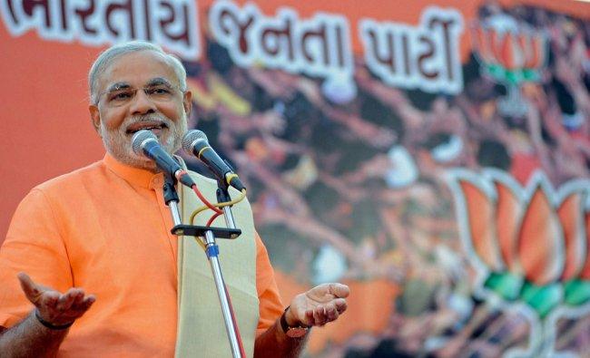 Gujarat Chief Minister Narendra Modi speaks after winning Gujarat assembly election, in...