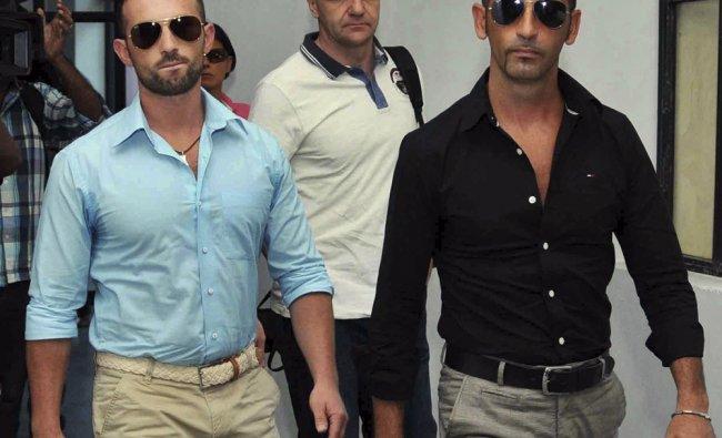 Italian marines Salvatore Girone, left, and Massimiliano Latorre, arrive at the office of Kochi...