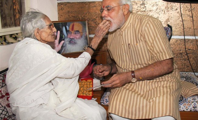 Gujarat Chief Minister Narendra Modi seeks blessings of his mother Hiraben after his party BJP\'s...