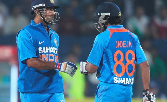 Indian captain M S Dhoni greets Jadeja for a shot during first India-England T20 match in Pune...