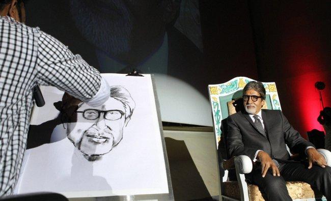 An artist sketches bollywood actor Amitabh Bachchan on the eve of 10th Chennai International Film...