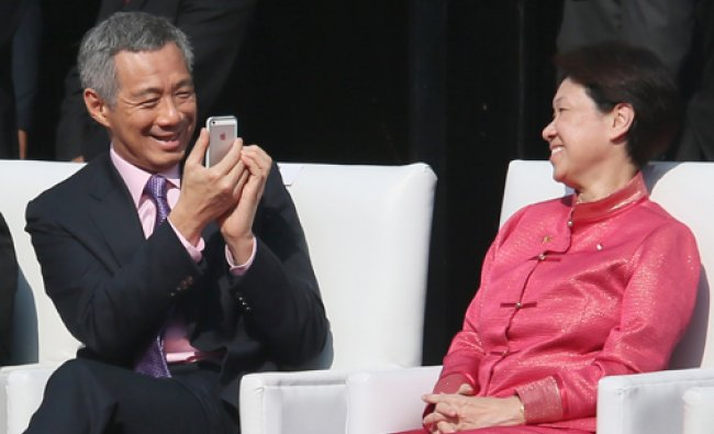 Singapore\'s Prime Minister Lee Hsien Loong, left, takes a photo of his wife Ho Ching during the...