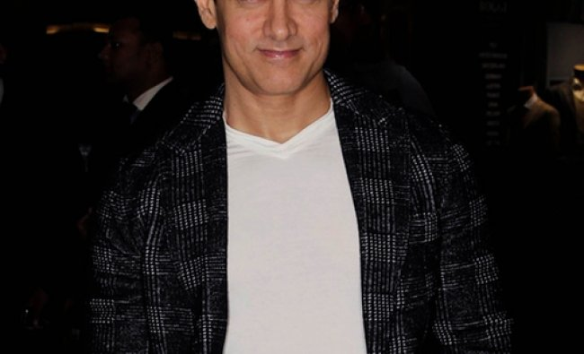 Actor Aamir Khan attends the premier of the Hindi film Dabangg2 in Mumbai on December...