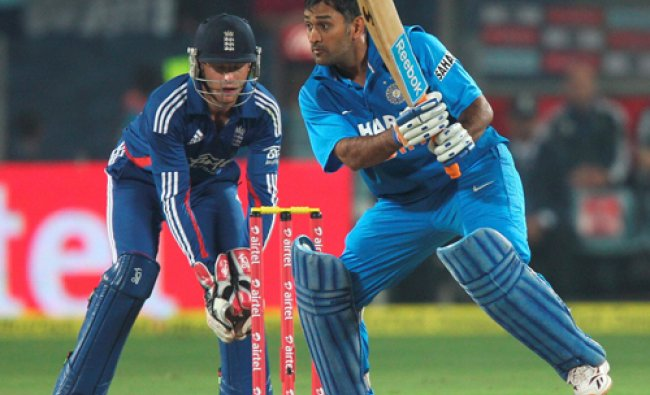 Indian captain M S Dhoni plays a shot during first India-England T20 match in Pune on Thursday...