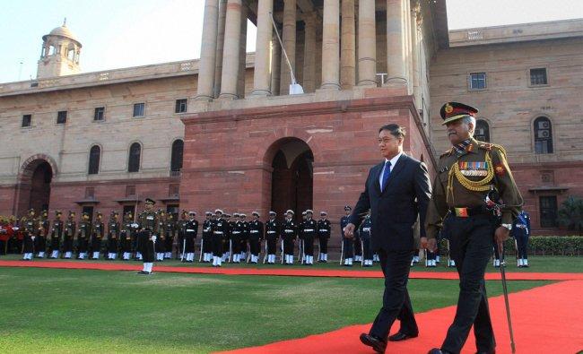 Thailand Defence Minister Air Chief Marshal Sukumpol Suwanatat inspects a guard of honour in Delhi..