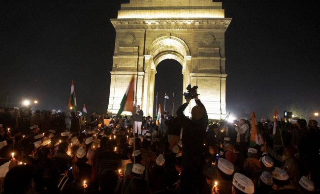 AAP activists light the candles at India gate to protests against gang rape of a girl...