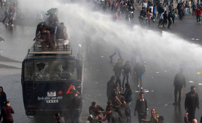 Protesters brave police water cannons during a protest to deemand justice for the gang rape victim..
