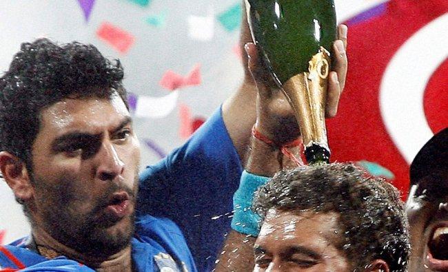 File photo of Sachin Tendulkar with Yuvraj Singh celebrate after winning the 2011 CWC in Mumbai...