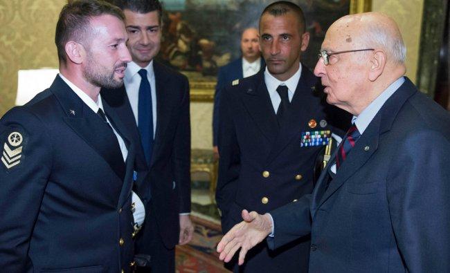 Italian President Giorgio Napolitano (R) greets two Italian marines Salvatore Girone (L)...
