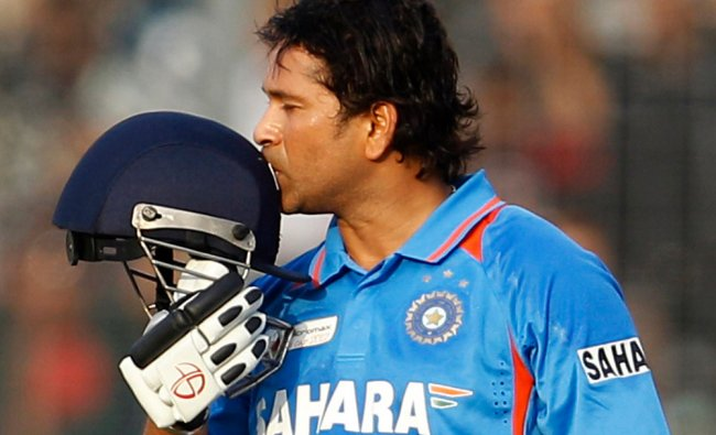 - In this Friday, March 16, 2012 file photo, Indian cricketer Sachin Tendulkar kisses his helmet...