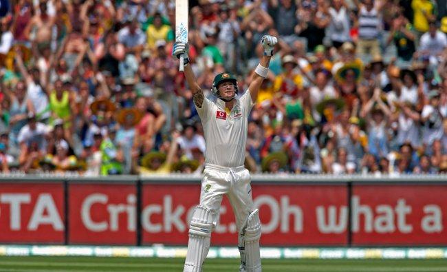 Australia\'s captain Michael Clarke celebrates reaching his century during the second day...