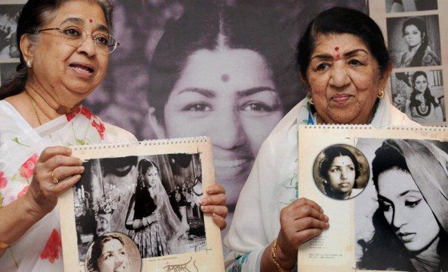 Legendary singer Lata Mangeshkar (R) along with her sister Usha raleasing \'Hamsafar 2013\'