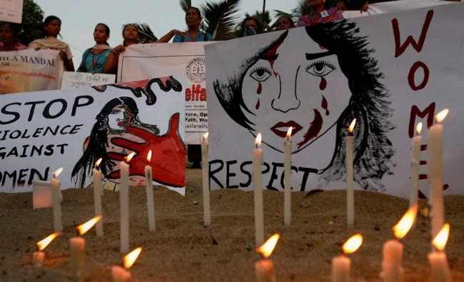 People light candles during a protest against Delhi gang rape case in Mumbai