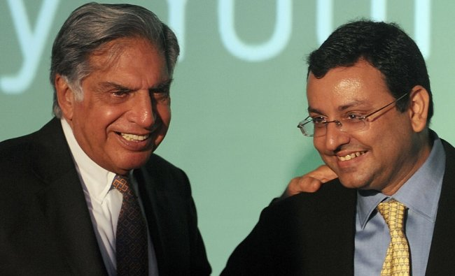 In this file photograph taken on April 23, 2012, Tata Sons chairman Ratan Tata (L) interacts....
