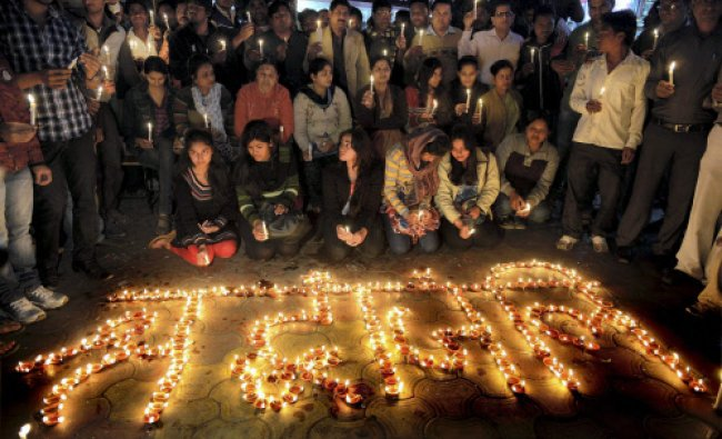 Youngsters light candles to pay tribute...