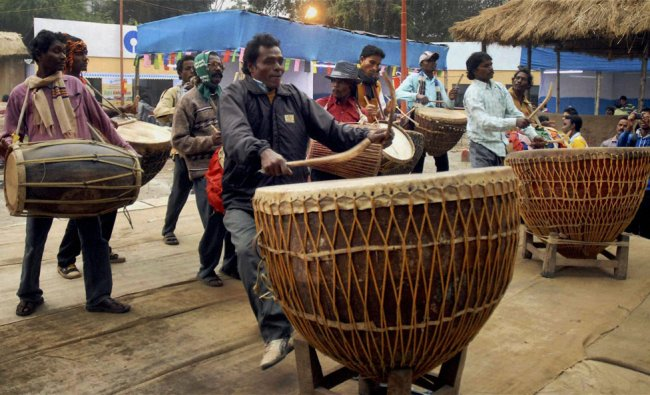 Folk musician from Midnapore playing giant drums during the inauguration of International Art &....