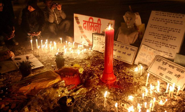 People pay tribute to the 23-yr-old gang-rape victim at Jantar Mantar in New Delhi on Monday.