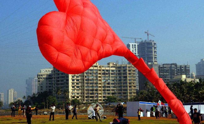 A participant flying a huge heart-shaped kite at the International Kite Festival in south Mumbai...