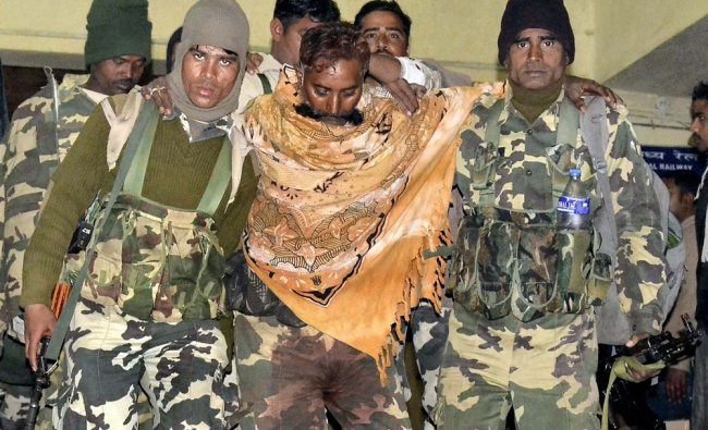 An injured CRPF jawan in Maoist attack is being taken to a hospital