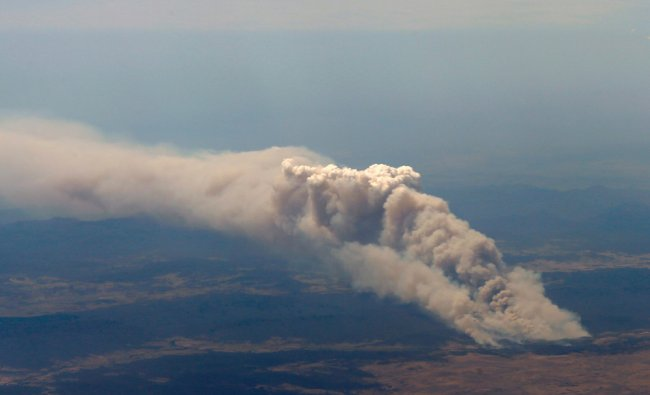 Smoke rises from the Yarrabin bushfire, burning out of control near Cooma...