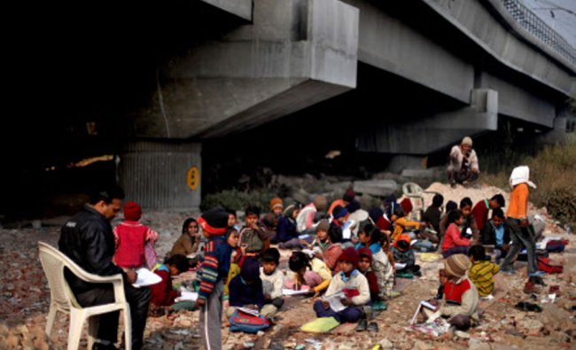 Underprivileged children attend a free school on a cold morning in New Delhi...