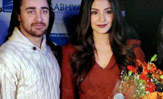 Imran Khan and Anushka Sharma pose during a promotional event