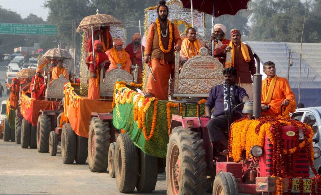 Sadhus take out a religious procession \'Peshwi\' as part of the Maha Kumbh festival in Allahabad....