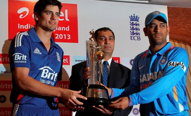 England Captain Alister Cook with Indian Captain M S Dhoni unveil the India England ODI Series...