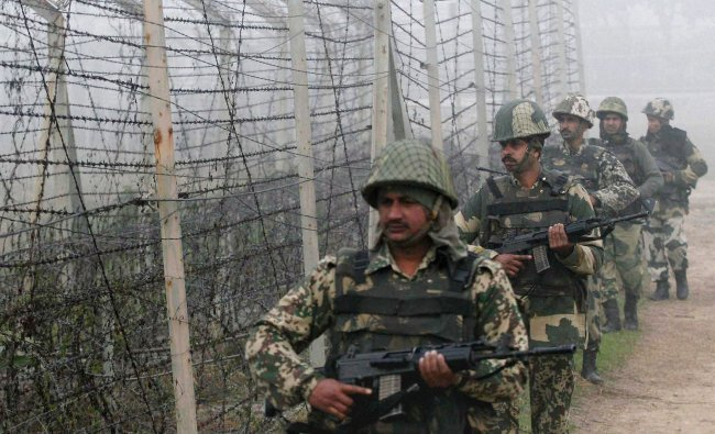 Border Security Force (BSF) soldiers patrol along the India-Pakistan border in Suchitgarh near...