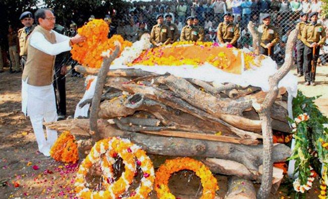 Madhya Pradesh Chief Minister Shivraj Singh Chouhan paying floral tributes to martyr Lance Naik...