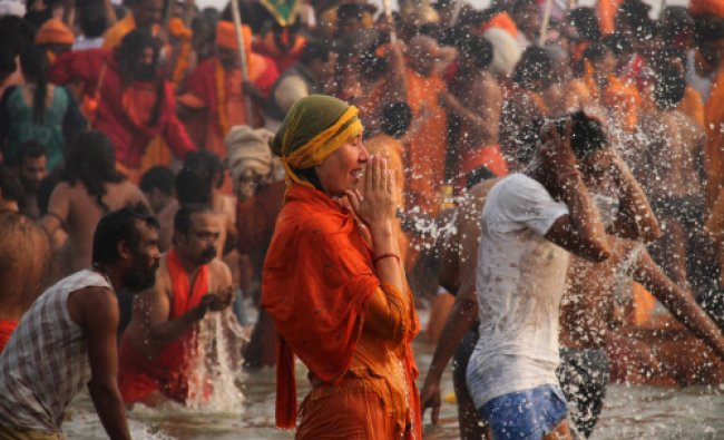 A foreign devotee prays at Sangam on one of the most auspicious day Makar Sankranti