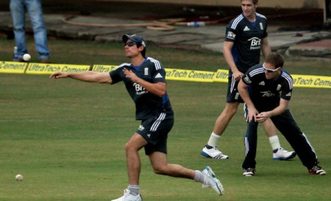 England skipper Alastair Cook throws the ball during a practice session