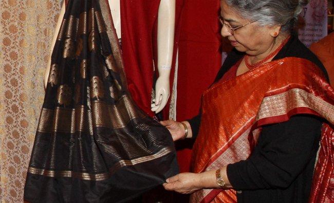 Gursharan Kaur, wife of Prime Minister Manmohan Singh takes a look on a saree...