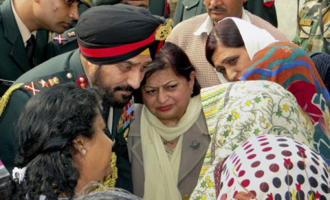Gen Bikram Singh and his wife Surjeet Kaur talks with family members of lance Naik Hemraj...