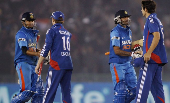 India\'s Suresh Raina and R Jadeja greeted by England\'s cricketers after winning the 4th ODI...
