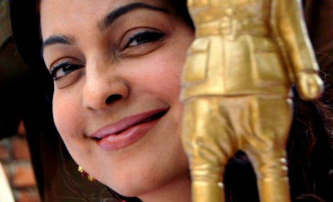 Indian Bollywood actress Juhi Chawla poses near a statue of Netaji Subhash Chandra Bose during...