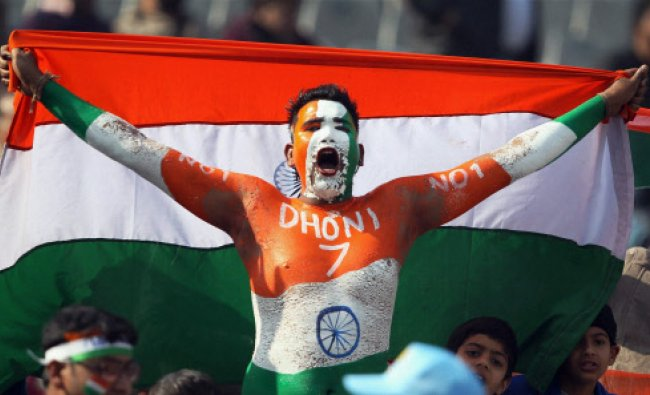A cricket fan jubilates with a Tricolour during the 4th India- England ODI cricket match at Mohali..
