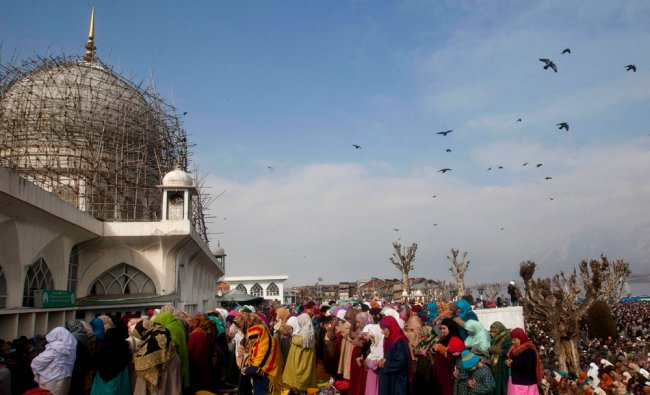 Kashmiri Muslims offer prayers at Hazratbal shrine on the birth anniversary of Prophet Muhammad