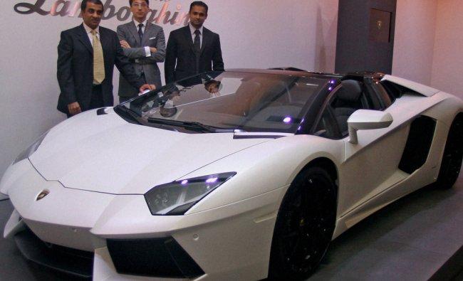 Members of Automobili Lamborghi at the unveiling of Lamborghini Aventador LP 700-4 Roadster