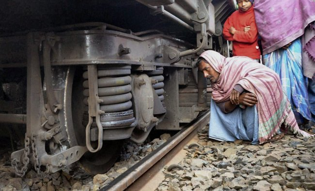 Locals gaze at wheels of Azimganj-Burdwan passenger train derailed near Murshidabad