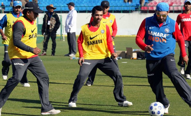 Indian team members playing football during a practice session in Dharamshala