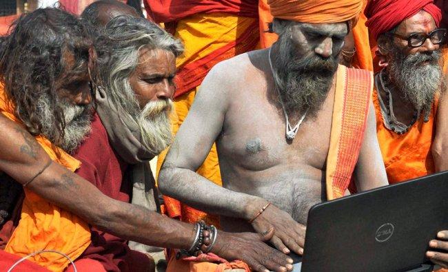 Sadhus using a laptop during Sadhu Mela at Berhampore in Murshidabad, West Bengal