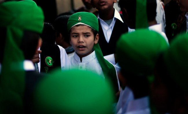 A boy takes part in a religious procession marking Eid-e-Milad-ul-Nabi, the birthday celebrations...