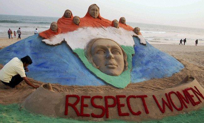 Sand artist Sudarsan Pattnaik creates a sand image depicting \'Bharat Mata\' with a message...