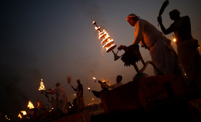 Hindu holy men worship the river Ganges during the Maha Kumbh festival in Allahabad....