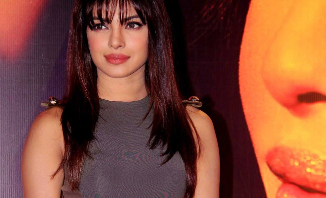 Priyanka Chopra poses for a photo during the launch of her album \'In My City\' in Mumbai...